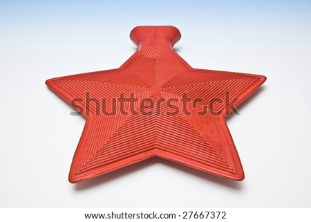 Star shaped hot water bottle. - stock photo