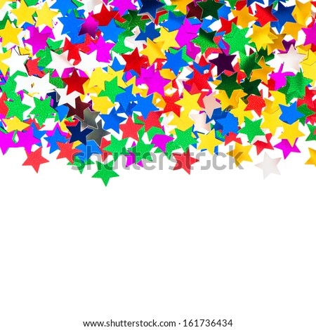 star shaped red, blue, green, gold confetti on white background. festive colorful background