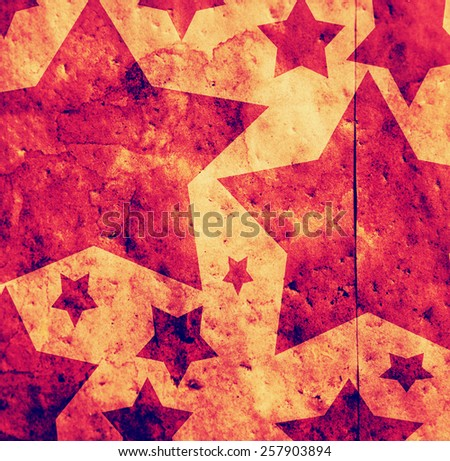 star shapes on a paper bag with texture added in toned with a retro vintage instagram filter app or action effect - stock photo