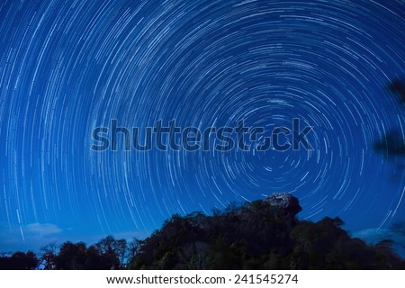 Star trails at Pha Hua Sing cliff in Nan province, Thailand - stock photo