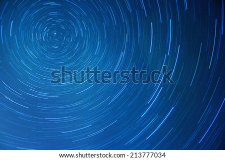 Star trails movement at night  - stock photo