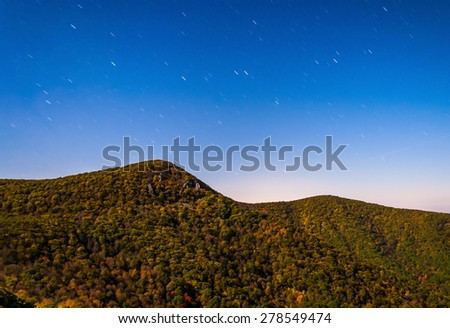 Star trails over Hawksbill Mountain in Shenandoah National Park, Virginia. - stock photo
