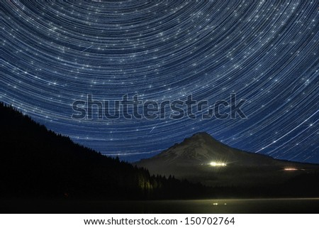 Star Trails Over Mount Hood at Trillium Lake Oregon with Perseid Meteors - stock photo