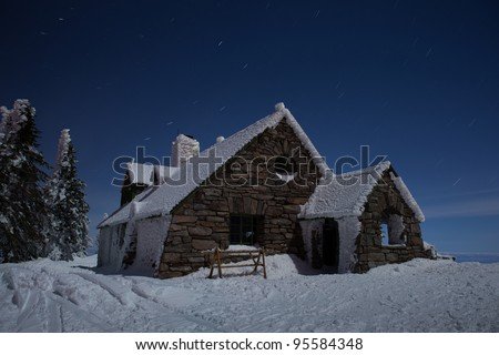 Star Trails Streaking over Ski Lodge on the top of a Mountain at Night
