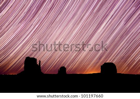 Star Trails Taken In Monument Valley Arizona Over a 2 Hour Time Lapse - stock photo