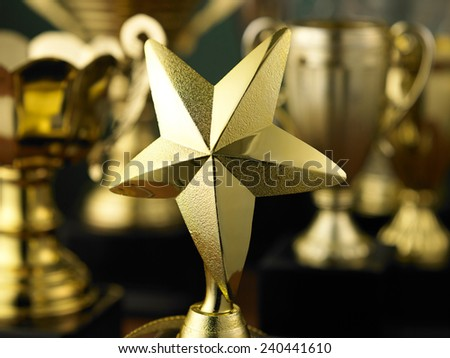star trophy standing out from others - stock photo