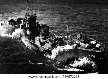 Starboard bow view of U.S. ship LCI 772, with camouflage painting. The patterns reduced the ship's visibility and confuse identity. July 30, 1944, World War 2. - stock photo