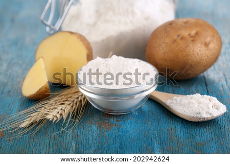Starch in bowl on wooden table close-up - stock photo