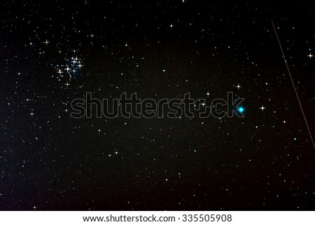 Starfield with Comet Lovejoy, Falling Star and Pleiades, Jan. 17, 2015 in Germany - stock photo