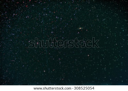 Starfield with Perseus, Andromeda Galaxy, Milky Way and Falling Stars - stock photo