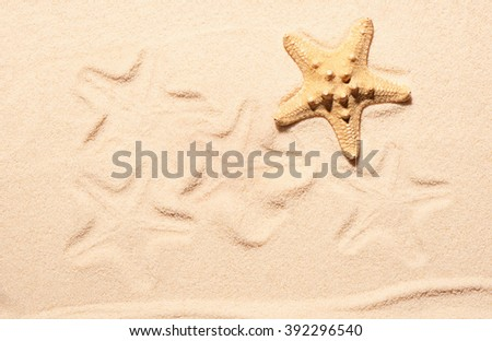 Starfish and marks of starfish on sand. Summer beach background. View from above - stock photo