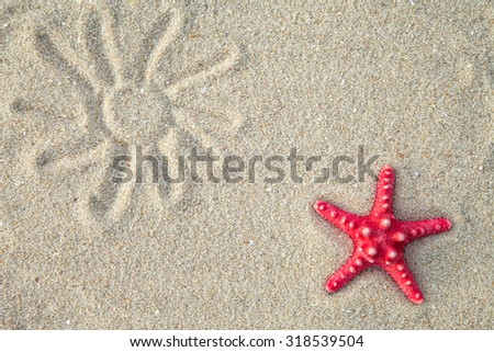 Starfish and sea shells with sand as background - stock photo