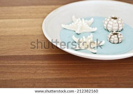 starfish and shell on wood table. interior decoration - stock photo