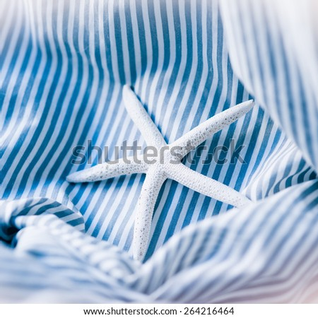starfish on a blue striped background - stock photo