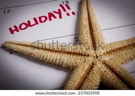 starfish on calendar - stock photo