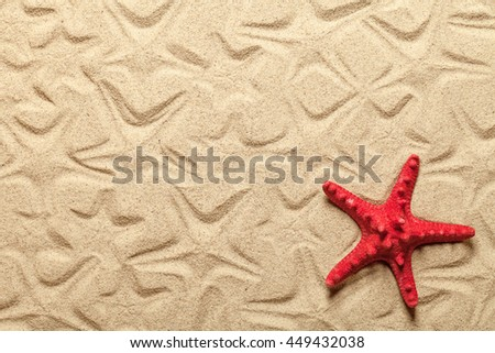Starfish patterns with red starfish on sandy beach for background