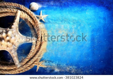 Starfish with a rope on a blue background - stock photo