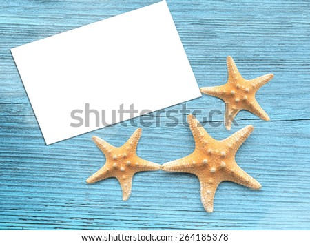 Starfish with blank  on the wooden blue background.