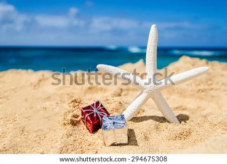 Starfish with gift boxes on the sandy beach in Hawaii, Kauai - stock photo