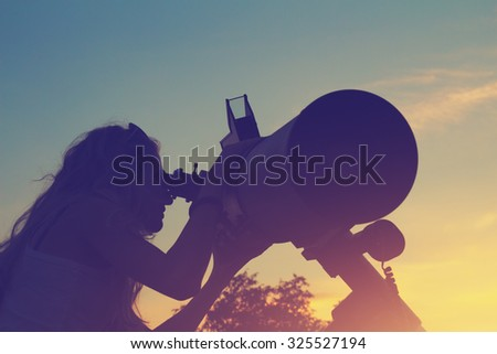 Stargazing through a telescope. - stock photo