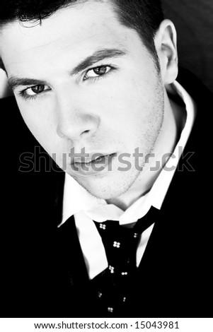 Staring businessman in dark black and white. - stock photo