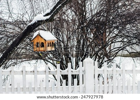 Starling-house in winter - stock photo
