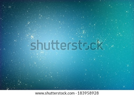 Starry glitter background with stars on blue color - stock photo