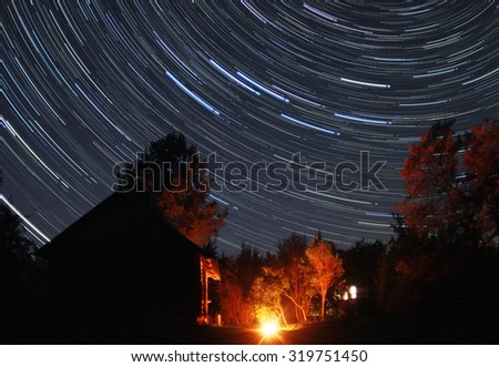 starry night in a village in Novgorod oblast, Russia - stock photo