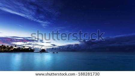 Starry night on Maldives, dark blue night sky over beach resort, beautiful nighttime seascape, luxury summer vacation and tourism concept  - stock photo