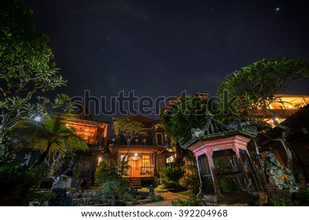 Starry night over the cottages and gardens in Ubud, Bali Island, Indonesia - stock photo
