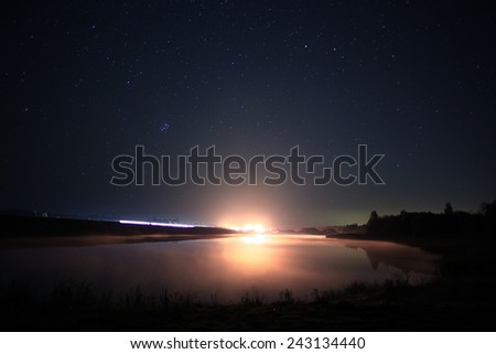 starry night sky landscape lake - stock photo