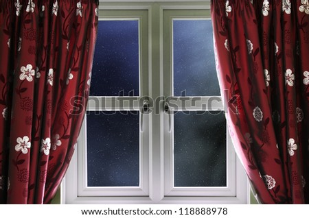 Starry night sky through a window - stock photo