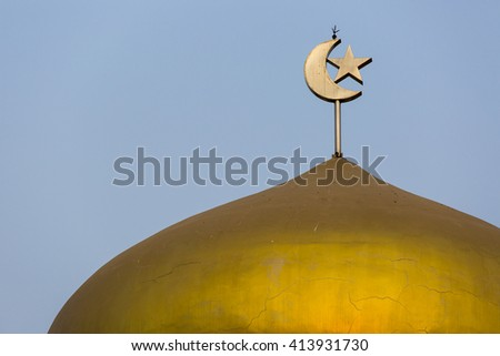 Stars and a month on The golden domes of Islamic symbols. - stock photo