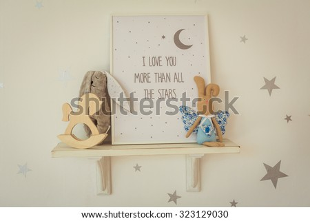 Stars and shelf with toys on the wall in bedroom - stock photo