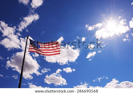 Stars and Stripes against sky - stock photo