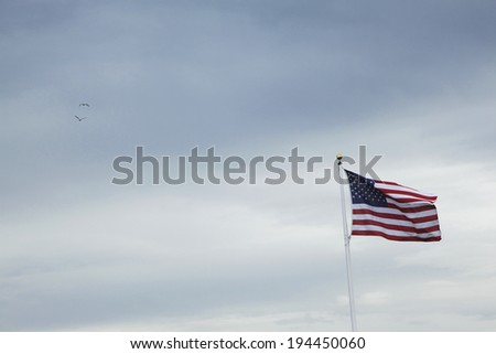 Stars and Stripes and cloudy sky - stock photo