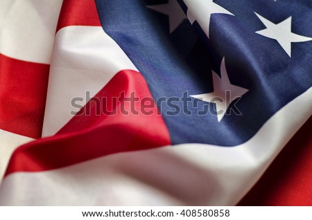 Stars and Stripes Flag background; rippling red white and blue silken American flag  - stock photo