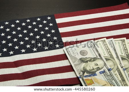Stars and stripes with cash/USA for Sale/money is laying on top of an American flag