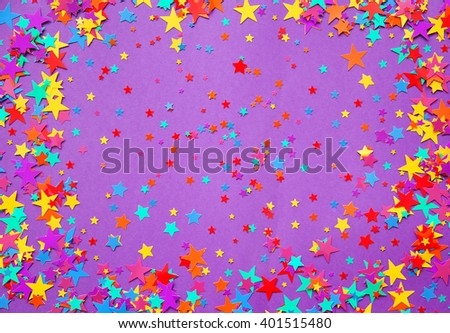 stars confetti on a purple background  - stock photo