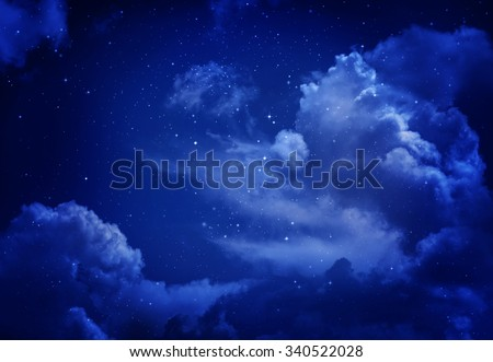 Stars in the night sky,blue background. - stock photo