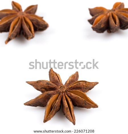 Stars of anise isolated on white background - stock photo