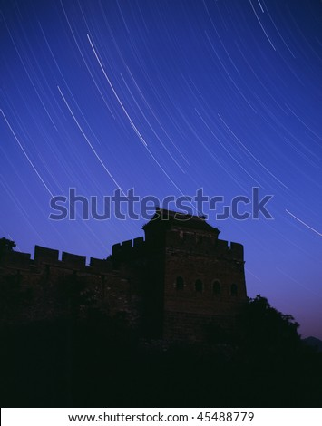 Stars track surrounding the Great Wall in a starry night. - stock photo