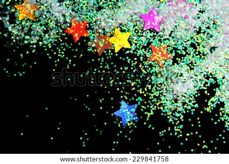 stars with glitter  on black - stock photo