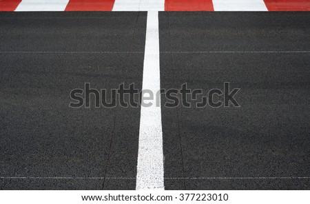 Start and Finish motor race line asphalt on Grand Prix street circuit - stock photo