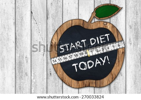 start diet today apple blackboard with measuring tape - stock photo