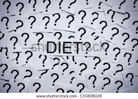 Start dieting? Many question marks on paper. Question concept. - stock photo