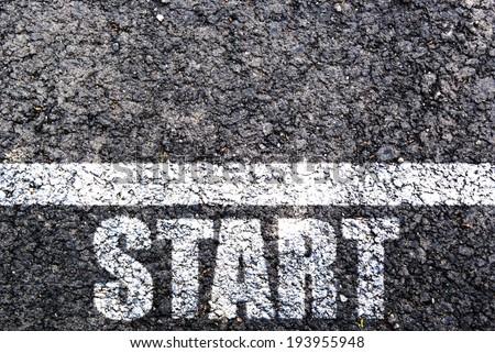 Start line on asphalt - stock photo