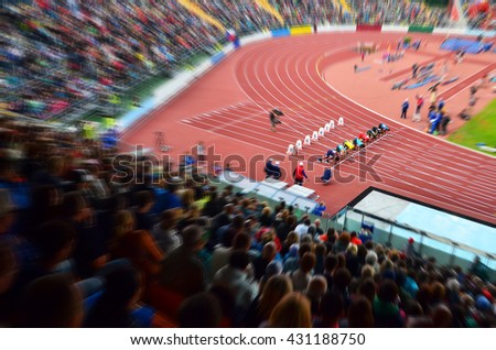 Start, 100m sprint, on athletic stadium.Nice background for olympic game in Rio - stock photo