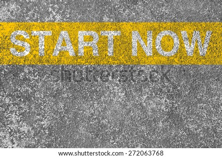 Start now yellow line is on the asphalt road. - stock photo