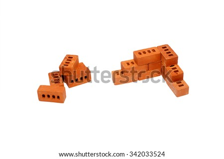 start of construction of the house. the beginning of the construction of a brick wall. the right angle of the toy bricks. next to a bunch of bricks for construction. Isolated on white background - stock photo